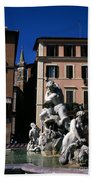 Fountain Depicting Neptune The Piazza Navona The Spire Of The Church Of Santa Maria Della Pace Rome Beach Towel