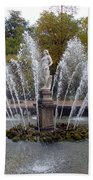Fountain On The Grounds Of The Peterhof Grand Palace Beach Towel