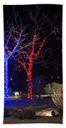 Four Lighted Trees Beach Towel