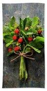 fresh Wild strawberries on wooden background  Beach Towel