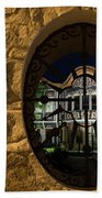 Illuminated Night View - Beautiful Revival House Through A Fence Window Beach Towel