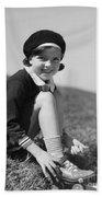 Girl Putting On Roller Skates, C.1930s Beach Towel