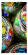 Glass Marbles In Containers Beach Towel