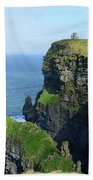 Grass Growing Along The Cliff's Of Moher In Ireland Beach Towel