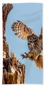 Great Horned Owl Returning To Her Nest Beach Towel