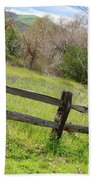 Green Hills And Rustic Fence Beach Towel