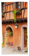 Half-timbered House Of Eguisheim, Alsace, France.  Beach Towel