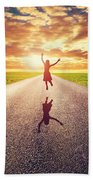 Happy Woman Jumping On Long Straight Road Beach Towel