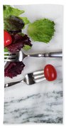 Healthy Organic Salad Flowing Out Of Plate On Natural Marble Tab Beach Towel