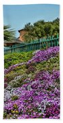 Hill Of Flowers Beach Towel