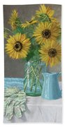 Homegrown - Sunflowers In A Mason Jar With Gardening Gloves And Blue Cream Pitcher Beach Sheet