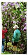 In The Lilac Garden Beach Towel