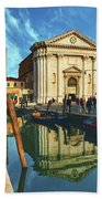 In The Waters Of The Many Venetian Canals Reflected The Majestic Cathedrals, Towers And Bridges Beach Towel
