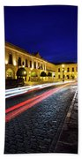 Indigo Sky And Car Lights Over Plaza Espana And Puente Nuevo Bri Beach Towel