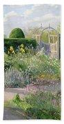 Irises In The Herb Garden Beach Towel