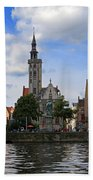 Jan Van Eyck Square With The Poortersloge From The Canal In Bruges Beach Towel