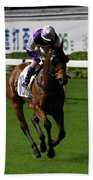 Jockey In Purple And White Riding Racehorse Beach Towel