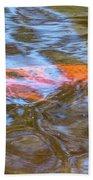 Koi Glimpses Beach Towel