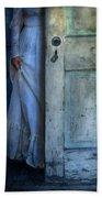 Lady In Vintage Clothing Hiding Behind Old Door Beach Towel by Jill Battaglia