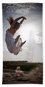 Leaping For The Sun Beach Towel