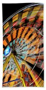 Light Streaks From The Spinning Ferris Wheel And Swing At Night  Beach Towel