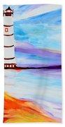Lighthouse By The Sea Beach Towel