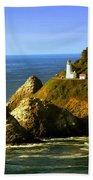 Lighthouse On The Oregon Coast Beach Towel