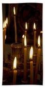lit Candles in church  Beach Towel
