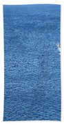 Lonely Fishing Boat Sailing On A Calm Blue Sea Beach Towel