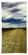 Long Dusty Road In Jal New Mexico  Beach Towel