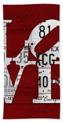 Love Sign Vintage License Plates On Red Barn Wood Beach Towel