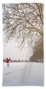 Man In Red Taking Picture Of Snowy Field And Trees Beach Towel