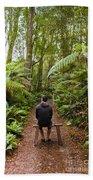 Man Relaxing In Strahan Rainforest Retreat Beach Towel