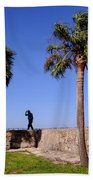 Man With A Hat On The Wall With Palm Trees In Saint Augustine Fl Beach Towel