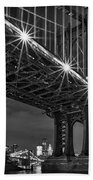 Manhattan Bridge Frames The Brooklyn Bridge Beach Towel by Susan Candelario