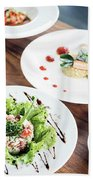 Mixed Modern Gourmet Fusion Food Dishes On Table Beach Towel