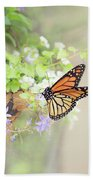 Monarch And Garden Basket Beach Towel