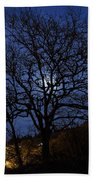 Moon Rise Behind Tree Silhouette At Night Beach Towel