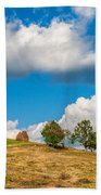 Mountain Landscape With Haystacks And Trees On Top Of Hill Beach Towel