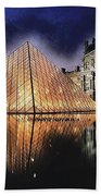 Night Glow Of The Louvre Museum In Paris  Text Louvre Beach Towel