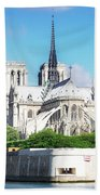 Notre Dame Over Water Beach Towel