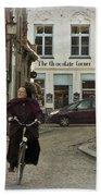 Nun On A Bicycle In Bruges Beach Towel