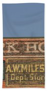Old Faded Advertisement On An Old Brick Building Beach Towel