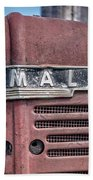 Old Farmall Tractor Grill And Nameplate Beach Towel