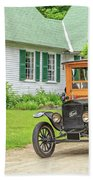 Old Model T Ford In Front Of House Beach Towel