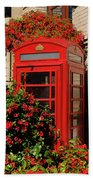 Old Red Telephone Box Or Booth Surrounded By Red Flowers In Toro Beach Towel