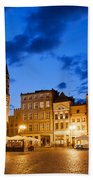Old Town Square By Night In Torun Beach Towel