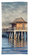 On A Cloudy Day At Naples Pier Beach Towel