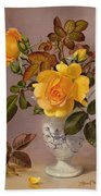 Orange Roses In A Blue And White Jug Beach Towel