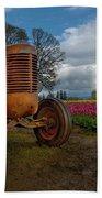 Orange Tractor At Tulip Field Beach Towel
